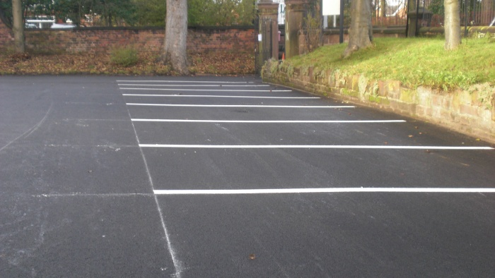 newly asphalted car park with markings