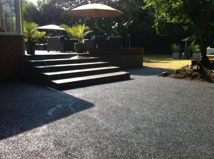 tarmac driveway with steps to a patio