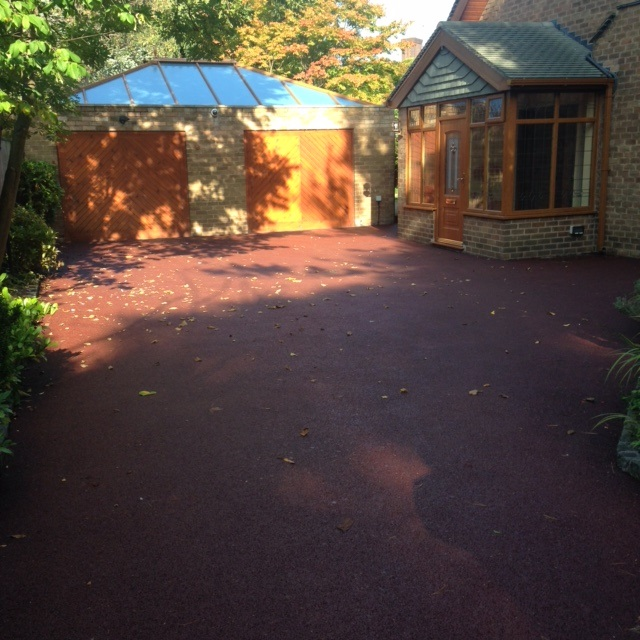 red tarmac driveway on a sunny day