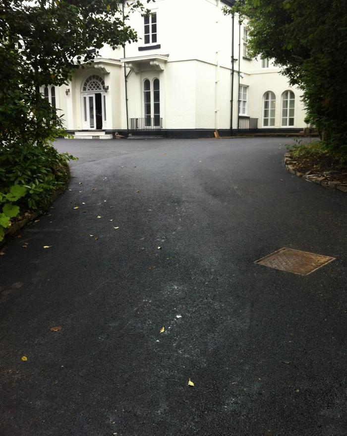 asphalt driveway for a big house