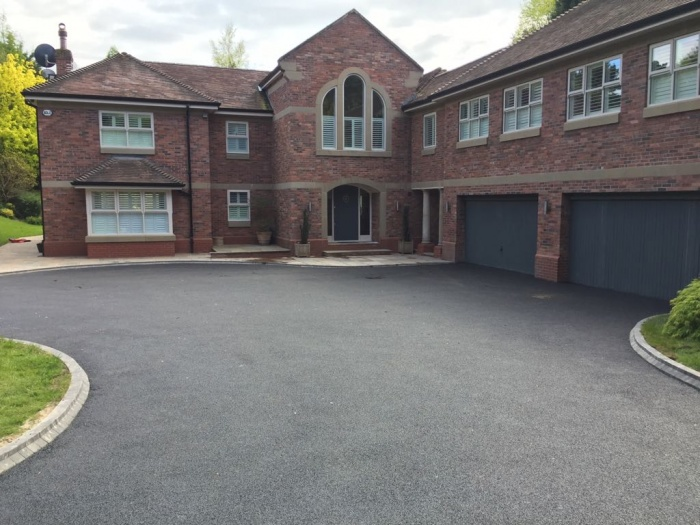tarmac driveway in front of a big house