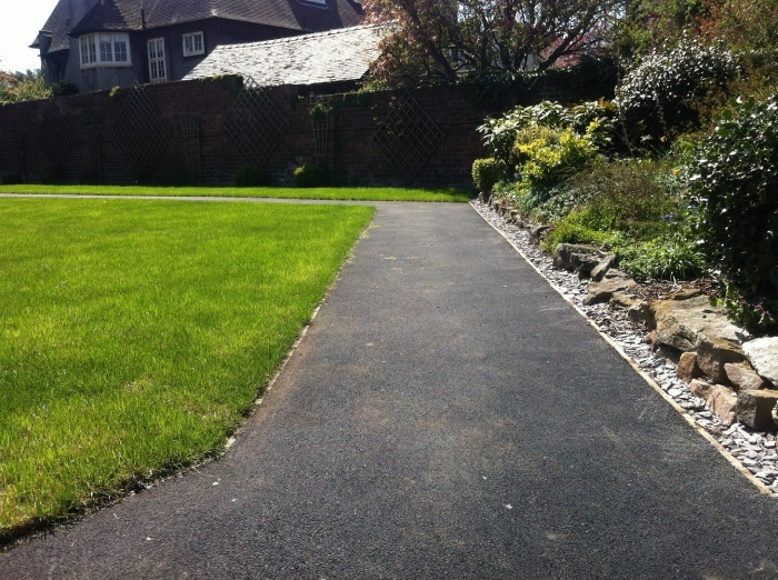 recently surfaced tarmac footpath by a green lawn