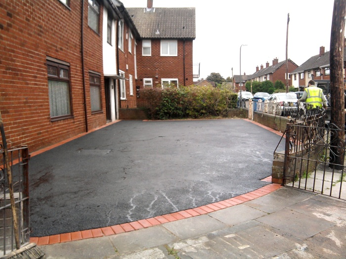 large driveway surfaced with asphalt