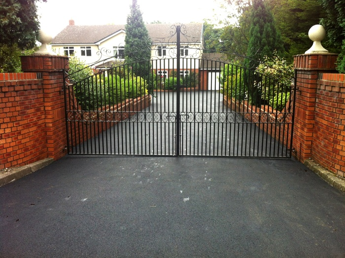 exclusive asphalt driveway with a gate