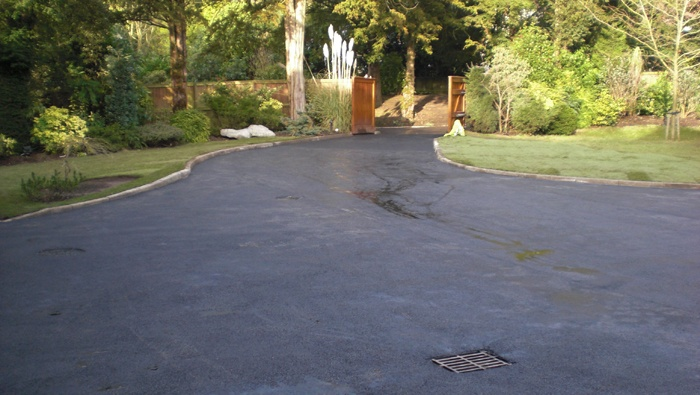 wet freshly surfaced tarmac driveway
